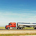 Semi Truck Moving On The Highway by Panoramic Images