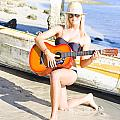 Smiling Girl Strumming Guitar At Tropical Beach by Jorgo Photography - Wall Art Gallery