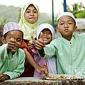 Smiling Muslim Children In Bali Indonesia by Jacek Malipan