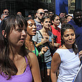 Some Young Ladies Enjoying The 2009 Cleansing Of 46th Street by James Connor