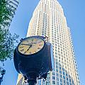 Standing By The Clock On City Intersection At Charlotte Downtown by Alex Grichenko