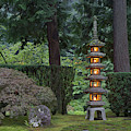 Stone Lantern Illuminated With Candles by William Sutton