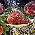 Strawberries by Manfred Lutzius