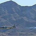 T-33 Shooting Star Flyby Nellis by Carl Deaville