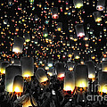 The Floating Lanterns In Thailand. by Panupong Roopyai
