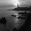 The Sun Is Setting Behind The Pigeon Point Light Station Near Ano Nuevo by Scott Lenhart