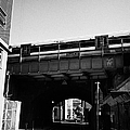 train going over railway bridge elevated section of track southwark London England UK by Joe Fox