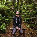 Travel Man Laughing In Tasmania Rainforest by Jorgo Photography - Wall Art Gallery