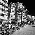 Tree Lined Seafront Promenade With Restaurants And Apartment Blocks Salou Catalonia Spain by Joe Fox