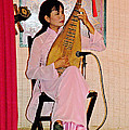 Two-stringed Lute Player At Wedding Ceremony Show In Binh Quoi Village-vietnam  by Ruth Hager