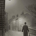 Victorian Or Edwardian Gentleman Walking Down A Cobbled Road At  by Lee Avison