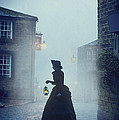 Victorian Woman With An Oil Lamp At Night On A Cobbled Street by Lee Avison