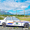 Watch Out For The Rcmp Near Destruction Bay In Yukon-canada by Ruth Hager