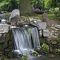 waterfall in park Klarenbeek in Arnhem Netherlands by Ronald Jansen