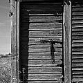 Weathered Door With Hanging Chain by Donald  Erickson
