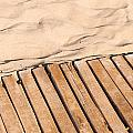 Weathered Wooden Boardwalk On Sand by Frank Gaertner