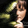 Woman Hiding Behind Fern Leaf by Jorgo Photography - Wall Art Gallery