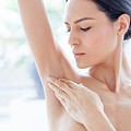 Woman Touching Her Underarm by Ian Hooton/science Photo Library
