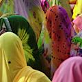 Women In Colorful Saris Gather by Keren Su