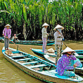 Women Waiting For Passengers On Mekong River Canal-vietnam by Ruth Hager