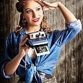 Young Retro Woman Holding Instant Camera by Jorgo Photography - Wall Art Gallery