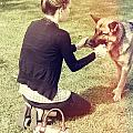 Young Woman In 20s Playing Fetch With Her Dog by Jorgo Photography - Wall Art Gallery