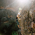 A Man Rock Climbing In Pinnacles by Ryan Tuttle