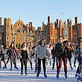 Ice Skating At Hampton Court Palace Ice Rink England Uk by Julia Gavin