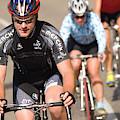 Cyclists Climb A Hill With A Mountain by Heath Korvola