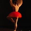 Ballet Dancer In Red Tutu by Lisa Cockrell