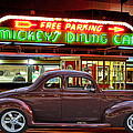 1940 Ford Deluxe Coupe At Mickeys Dinner  by Gary Keesler