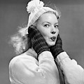 1950s Young Woman Pursing Lips Hands by Vintage Images