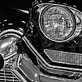 1957 Cadillac Coupe De Ville Headlight by Michael Gordon