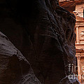 A Glimpse Of Al Khazneh From The Siq In Petra Jordan by Robert Preston
