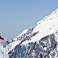 A Man Skis Untracked Powder Off-piste by Henry Georgi