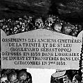 A Marker With Skulls And Bones In The Catacombs Of Paris France by Richard Rosenshein