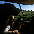 A Woman Sits In Her Safari Jeep by David McLain