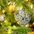 Bauble In A Christmas Tree  by U Schade