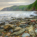 Beautiful Warm Vibrant Sunrise Over Ocean With Cliffs And Rocks by Matthew Gibson