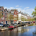 Boats On Amsterdam Canal by Artur Bogacki
