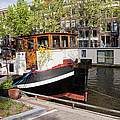 Canal In The City Of Amsterdam by Artur Bogacki