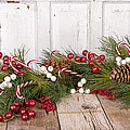Christmas Berries On Wooden Background by Jennifer Huls
