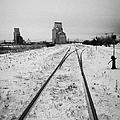 Cn Canadian National Railway Tracks And Grain Silos Kamsack Saskatchewan Canada by Joe Fox