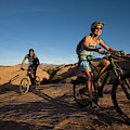 Couple Mountain Biking, Moab, Utah by Whit Richardson
