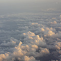 Cumulus Clouds At Sunset by Jon Van de Grift