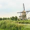 Dutch Landscape With Windmills by Carol Groenen