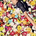 Fashion Model Posing With Flowers by Jacek Malipan