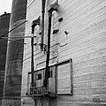 grain elevator doors and filling pipe leader Saskatchewan Canada by Joe Fox
