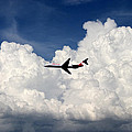 Jetliner And Clouds by Carl Purcell