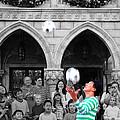 Juggler In Epcot Center by Jim Hughes